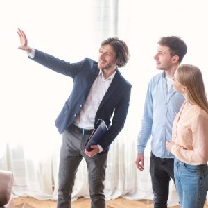 millennial-couple-with-real-estate-agent-visiting - 7WHSAAK